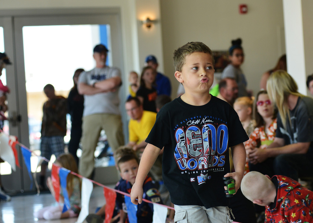 Andrew Stewart, 7, breathes a sigh of relief after winning a round during the business class of the Elakawee District Pinewood Derby Saturday at Hammer Chevrolet.