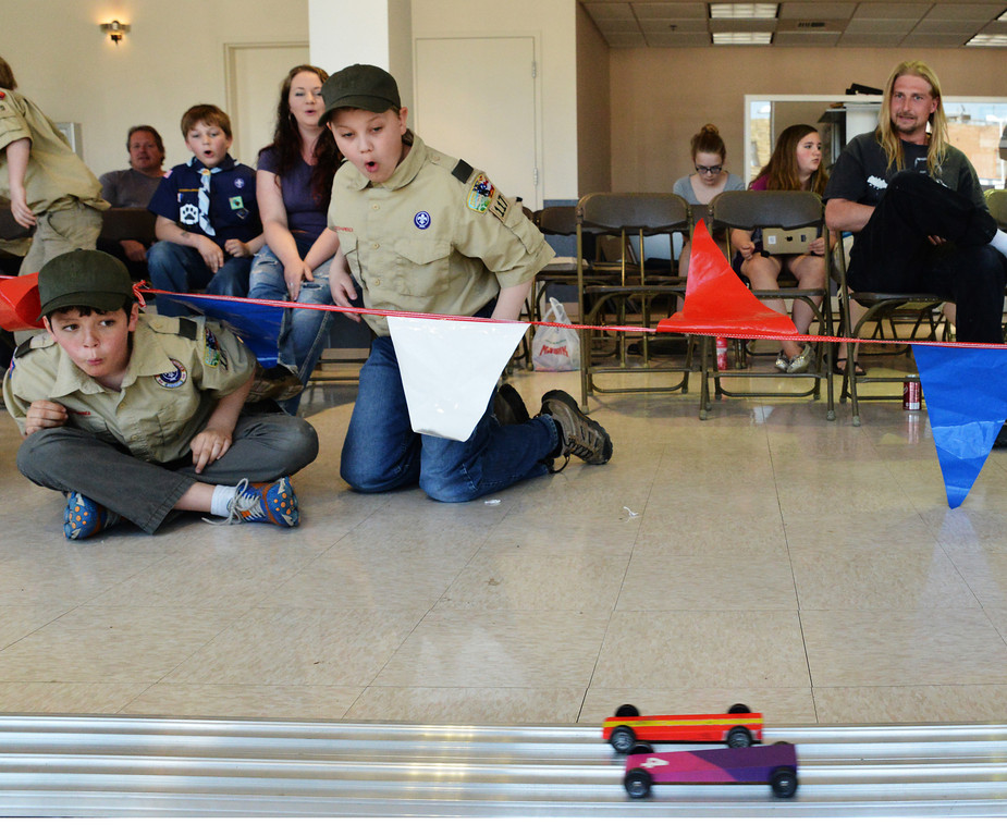 Cubscouts Gaige Vielhauer, left, and Ben Novoteny watch the derbies roll down the track during the Elakawee District Pinewood Derby Saturday at Hammer Chevrolet.
