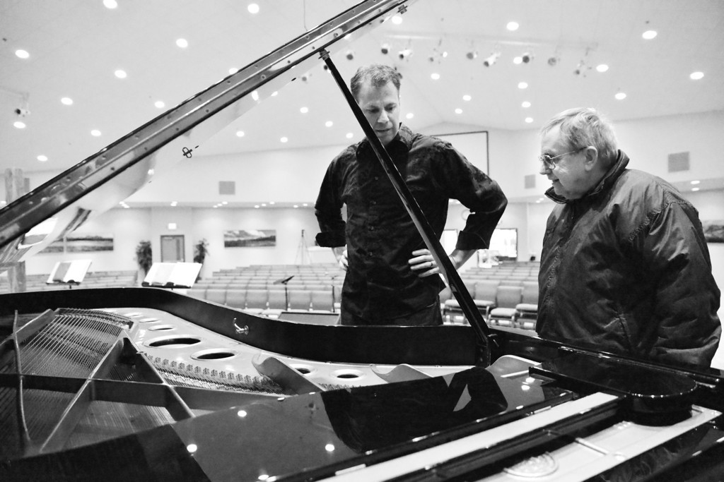 """Senior Pastor John Craft, left, and Ron Krikac look over the 9-foot long Bechstein Grand Piano last Wednesday, April 16, after delivery at First Baptist Church in Sheridan. The 1400-pound piano was purchased for use by the congregation's regular worship services and to attract community classical music events in collaboration with the Sheridan Arts Council. """"We want to fill a hole in the artistic calendar in Sheridan."""" Craft said. The primary reason for the purchase was to open up the building to classical music presentations. The first classical music event is presented by the Piatigorsky Foundation, which is set for this May 8, at 7 p.m. and is free to the public. The Classical Music Concert will feature Katie Calcamuggio, a mezzo-soprano, and John Elam on piano."""