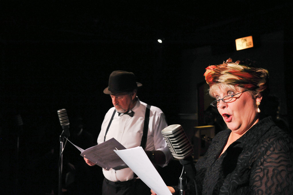 "Steve Baskin as Gil Whitney, left, and Kandi Davis as Fay Grandvile practice lines from the classic radio series 'Romance of Helen Trent' during a stage rehearsal of ""Wireless: Live Readers Theater from the Golden Age of Radio"" Tuesday at the Carriage House Theater. The act will include several transcripts from classic radio programs. The show emulates the radio studio performance complete with live sound effects by sound artists. Curtain opens this Friday and Saturday at 7:30 p.m. and Sunday at 2 p.m. The Sheridan Press