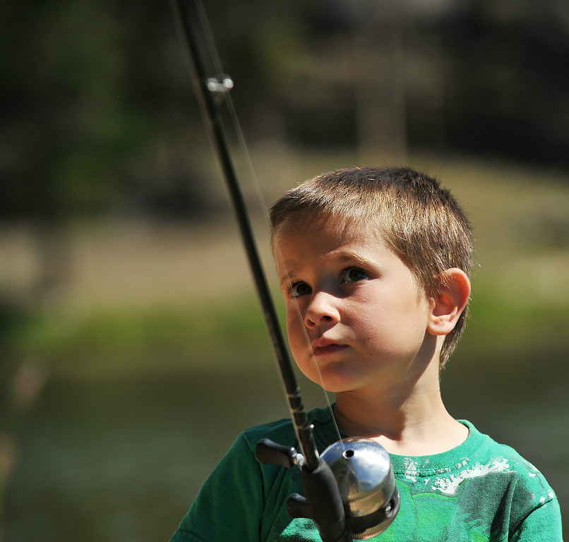 Four-year-old Calder Vollmer of Dayton prepares to cast a line at Sibley Lake Saturday morning in the Bighorn Mountains. The Sheridan Press|Justin Sheely.