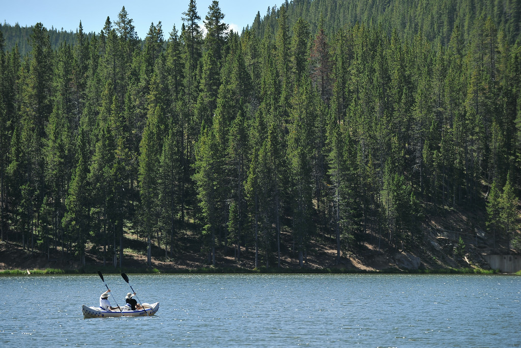 A couple paddles their canoe across Sibley Lake Saturday morning in the Bighorn Mountains. The Sheridan Press|Justin Sheely.