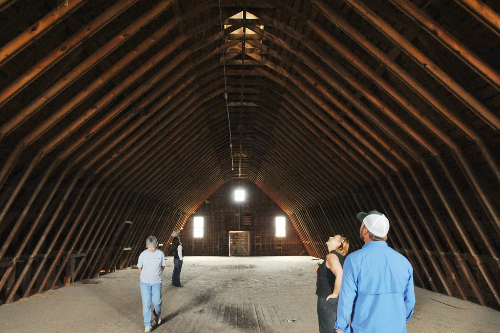 A group tours the second floor of the Brinton Barn Wednesday on the Quarter Circle A Ranch near the Brinton Museum. The historic barn was built by Bradford Brinton in 1928. After Brinton's death, the Wallop family leased the barn to dress their horses for playing polo at the polo club adjacent to the barn. The barn is currently being leased to the Flying H Ranch. The Sheridan Press|Justin Sheely.