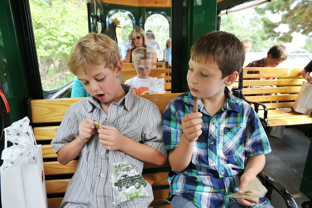 Noah Smith, left, and Caleb Adsit, both in first grade in Big Horn, take a look at the goodies given by the Brinton Museum director during a visit to the Binton on the Sheridan Trolley for the Summer Reading Challenge celebration Wednesday on Brinton Road in Big Horn. 31 students took on the 'MyOn Summer Reading Challenge' and read 977 books throughout the summer collectively. The students had to read 10 books or more to receive a medal; the gold medalists read 50 books or more. On Wednesday, the gold medalists were awarded a special trip on the Sheridan Trolley to the Brinton Museum where the director presented gifts to the children. The debut reading program was intended to encourage students to read through the summer.