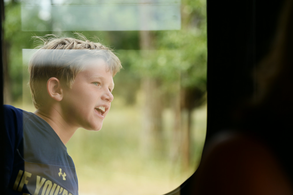 Big Horn Fourth grader Cooper Garber looks out the window of the Sheridan Trolley during the Summer Reading Challenge celebration Wednesday on Brinton Road in Big Horn. 31 students took on the 'MyOn Summer Reading Challenge' and read 977 books throughout the summer collectively. The students had to read 10 books or more to receive a medal; the gold medalists read 50 books or more. On Wednesday, the gold medalists were awarded a special trip on the Sheridan Trolley to the Brinton Museum where the director presented gifts to the children. The debut reading program was intended to encourage students to read through the summer.