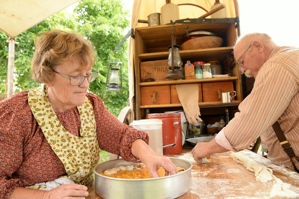 Carol McCaffree, left, and Dan McCaffree of Roundup, Montana, prepare a dish for the chuckwagon cook off during Big Horn Heritage Days celebration Saturday at Big Horn. Several cooks from parts of Montana and South Dakota brought their old time chuckwagons to the cook off event and prepared meals to be judged. Each Chuckwagon was also judged on appearance and accuracy to the time period of the old cattle driving days of the west. Chuckwagon meal tickets were also sold for those visiting the events in Big Horn. The Sheridan Press|Justin Sheely.