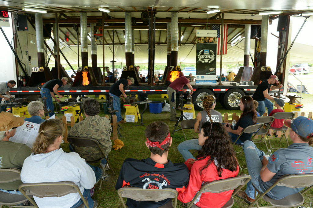 Spectators, blacksmiths, and family members watch as several competitors work in the match <br /> set of horseshoe making for the the World Championship Blacksmiths competition during Don King Days at the Big Horn Equestrian Center. 70 competitors came from several countries across the globe to compete at the horse show competition. This is the third stop on a five-stop championship tour which ends at the world championships in Orlando, Florida, this December. The Sheridan Press|Justin Sheely.