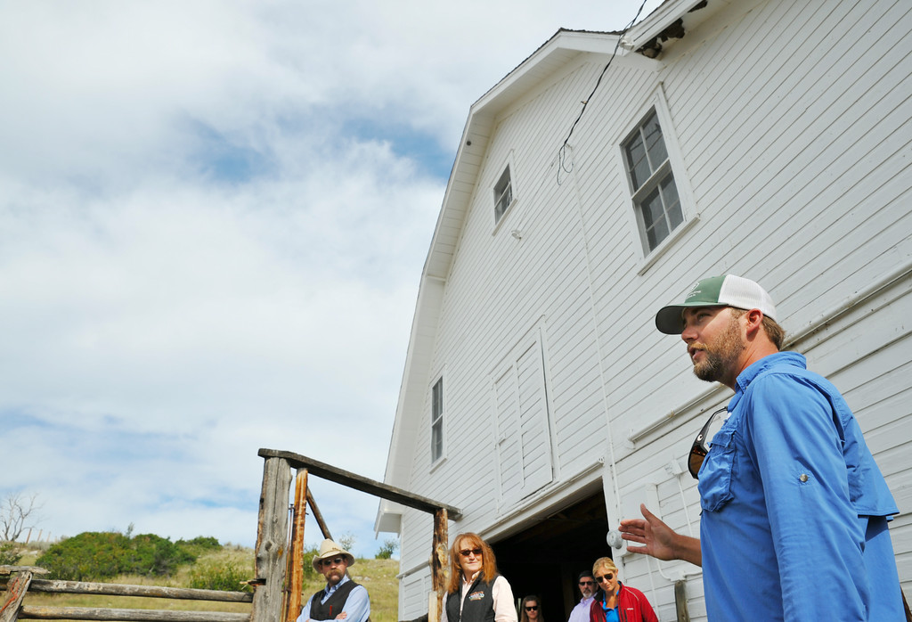 Horse Trainer Gus Whitelaw of St. Louis, Missouri, talks about training polo playing horses to an interested group Wednesday at the Brinton Barn on the Quarter Circle A Ranch near the Brinton Museum. The historic barn was built by Bradford Brinton in 1928. After Brinton's death, the Wallop family leased the barn to dress their horses for playing polo at the polo club adjacent to the barn. The barn is currently being leased to the Flying H Ranch. The Sheridan Press|Justin Sheely