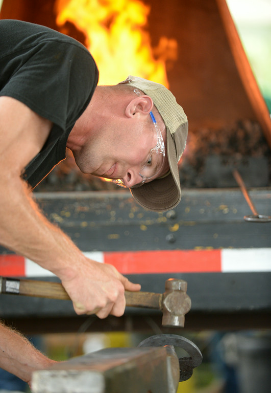 Oklahoma blacksmith Matt Kachnavage competes in the match set of horseshoe making for the the World Championship Blacksmiths competition during Don King Days at the Big Horn Equestrian Center. 70 competitors came from several countries across the globe to compete at the horse show competition. This is the third stop on a five-stop championship tour which ends at the world championships in Orlando, Florida, this December. The Sheridan Press|Justin Sheely.