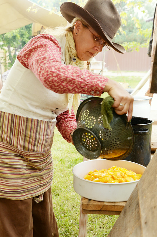 Georgianna Lipus of Hamilton, Montana, prepares a dish of peach cobbler for the chuckwagon cook off during Big Horn Heritage Days celebration Saturday at Big Horn. Several cooks from parts of Montana and South Dakota brought their old time chuckwagons to the cook off event and prepared meals to be judged. Each Chuckwagon was also judged on appearance and accuracy to the time period of the old cattle driving days of the west. Chuckwagon meal tickets were also sold for those visiting the events in Big Horn. The Sheridan Press|Justin Sheely.