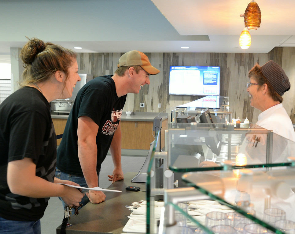 Sheridan College students Callie Allen, left, and brother Steven Allen jest with kitchen staffer Marie Ferber as they order lunch Friday in the Thorne-Rider Campus Center at Sheridan College. The new campus center features restaurant quality meals with the option of an all-you-can-eat buffet. The restaurant is open to the public for breakfast, 7 a.m. to 10 a.m., lunch, 10:30 a.m. to 2 p.m., and dinner from 5 to 7 p.m. The brick oven style pizza parlor on the lower level is open until midnight. The Sheridan Press|Justin Sheely.