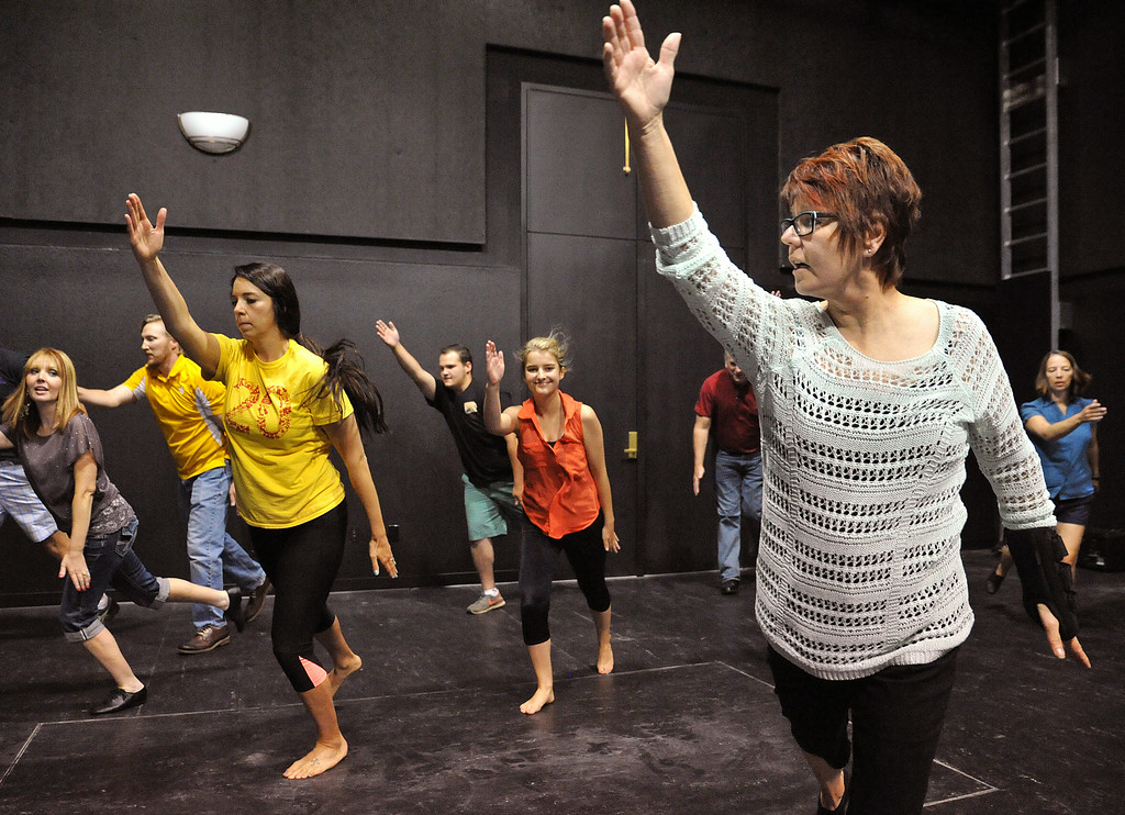 "Marva Craft, right, puts a group of hopefuls through a basic dance routine during the auditions for ""42nd Street"" Wednesday night at the Mars Theater. Craft is directing the musical, which will be the feature production at this year's Gala fundraiser for the WYO Theater on October 18. The Sheridan Press