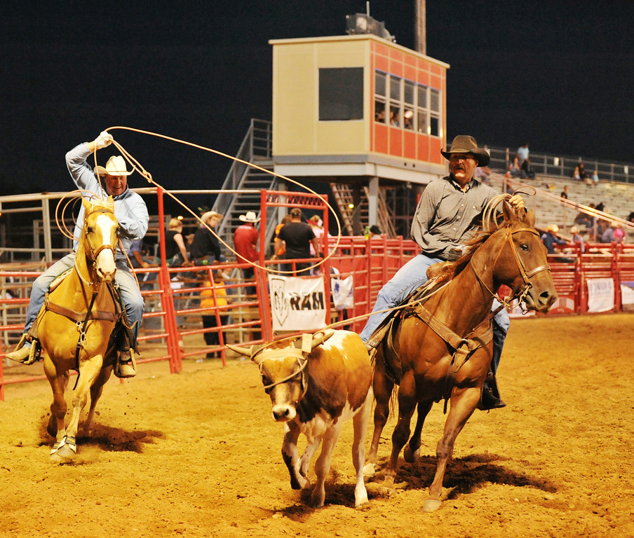 Lenard Gorzalka, left, and Mike Albrecht compete in century team roping Saturday evening during The Sheridan County Rodeo at the Sheridan County Fairgrounds arena. In century team roping the two member's combined age much reach one hundred years or greater. The Sheridan Press|Justin Sheely.
