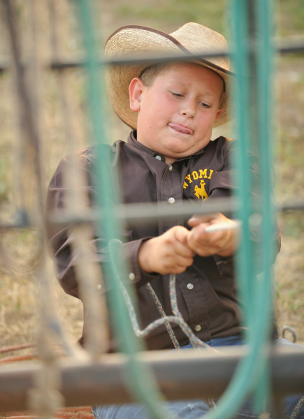 Twelve-year-old Thomas Sorenson pulls on a rope during the Sheridan County Rodeo Friday night at the Sheridan County Fairgrounds. The Sheridan Press Justin Sheely.