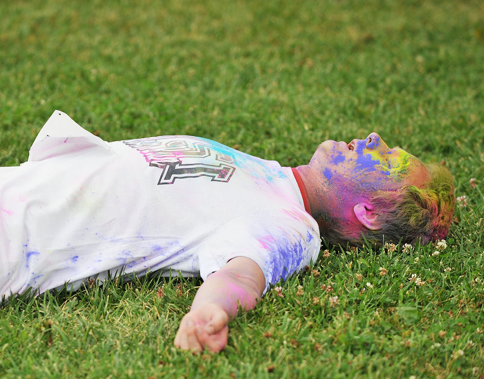 Seventeen-year-old Robert Bruner takes a breather after finishing the 5k color run during the NSI Fall Festival Saturday at NSI out on Big Goose Road. The color run was part of the fall festival in which the community was invited to participate. Normative Services currently has 73 students on campus from Montana, Wyoming, California, Nebraska, and Washington represented. The Sheridan Press|Justin Sheely.