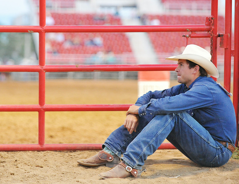 Rodeo competitor Jeff Campbell waits behind the gate to pull out the barrels for a barrel racing event Saturday evening during the Sheridan County Rodeo at the Sheridan County Fairgrounds arena. Many of the competitors and their family members helped with behind-the-scenes work for a smooth rodeo performance throughout the weekend. The Sheridan Press Justin Sheely.