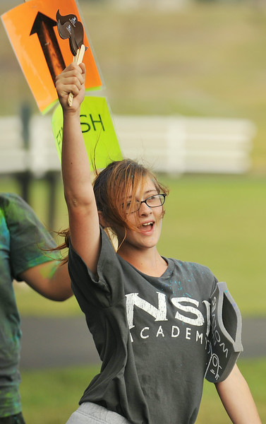 NSI junior Nicole Waddell cheers on runners passing in the color run 5k during the NSI Fall Festival Saturday at NSI out on Big Goose Road. The color run was part of the fall festival in which the community was invited to participate. Normative Services currently has 73 students on campus from Montana, Wyoming, California, Nebraska, and Washington represented. The Sheridan Press Justin Sheely.