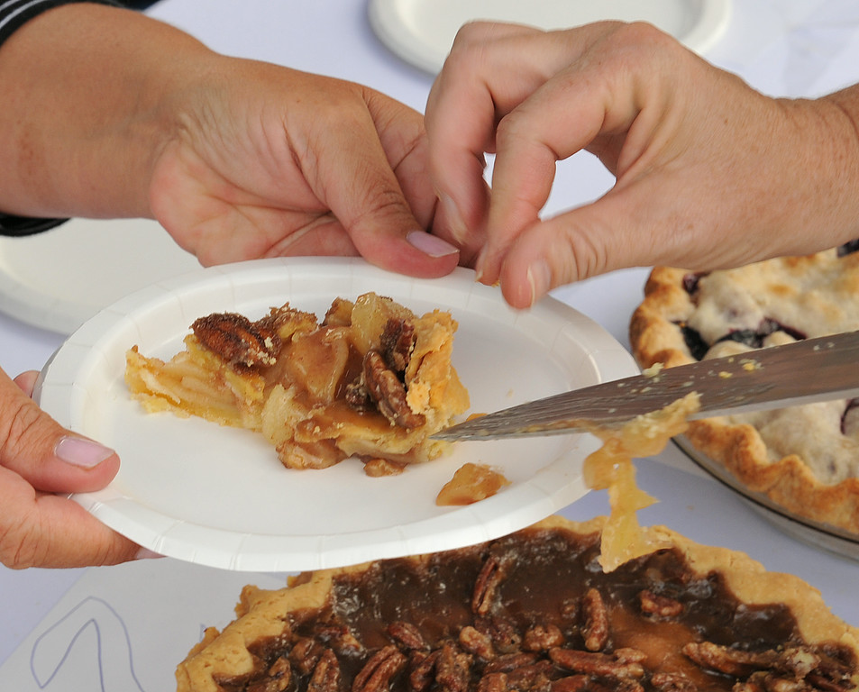A slice of pecan pie is given to a judge during the pie contest at the Farmer's Market Thursday.