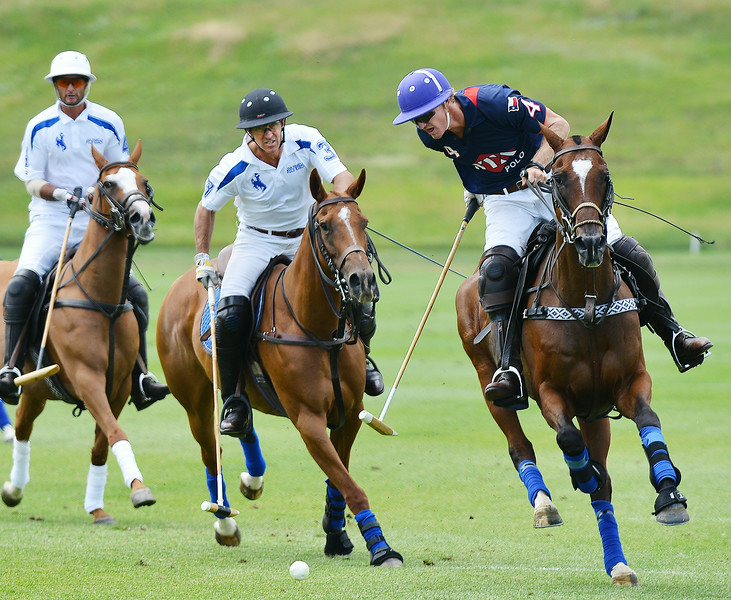 Adam Snow, middle, watches the ball as Jason Crowder approaches with his mallet for a game-winning goal during the early afternoon game Thursday at the Flying H Polo Club. Crowder's goal won the game in a sudden death match after going into overtime. The Sheridan Press Justin Sheely.