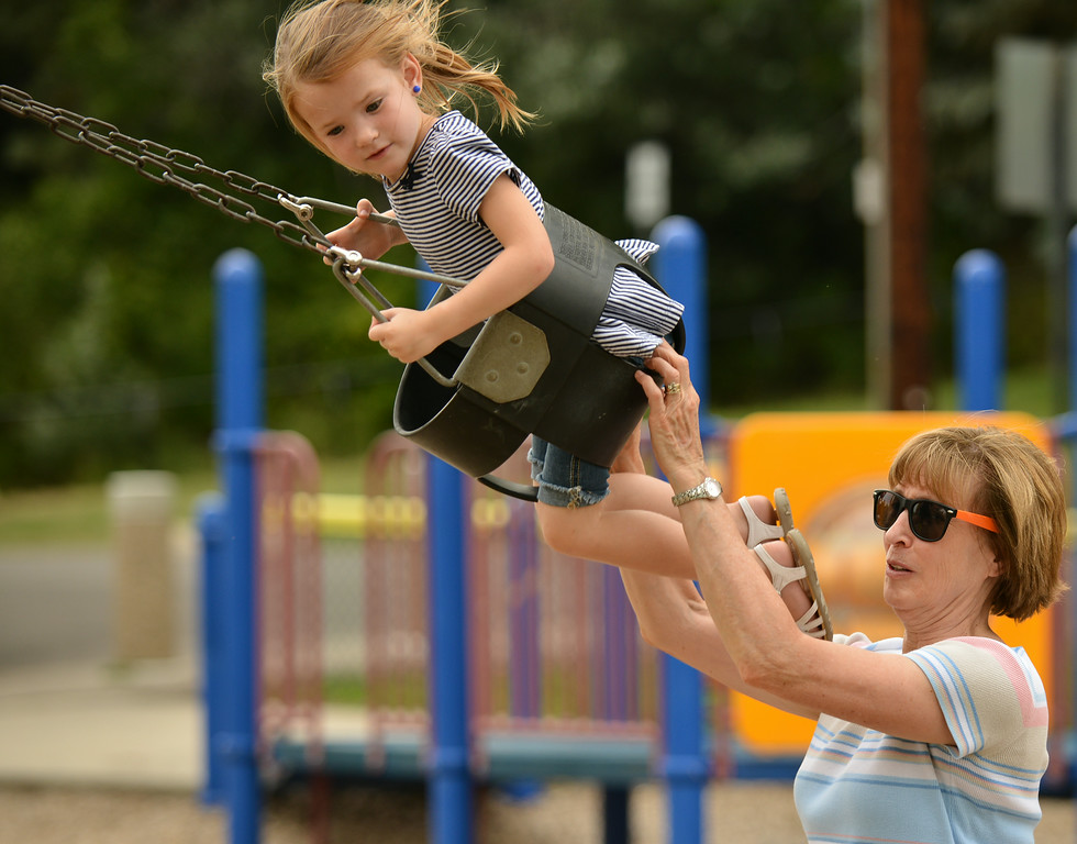 Four-year-old Macie Anderson holds onto the swing as her great aunt Marcia Gonda gives her a push Wednesday evening at Kendrick Park. The Sheridan Press|Justin Sheely.