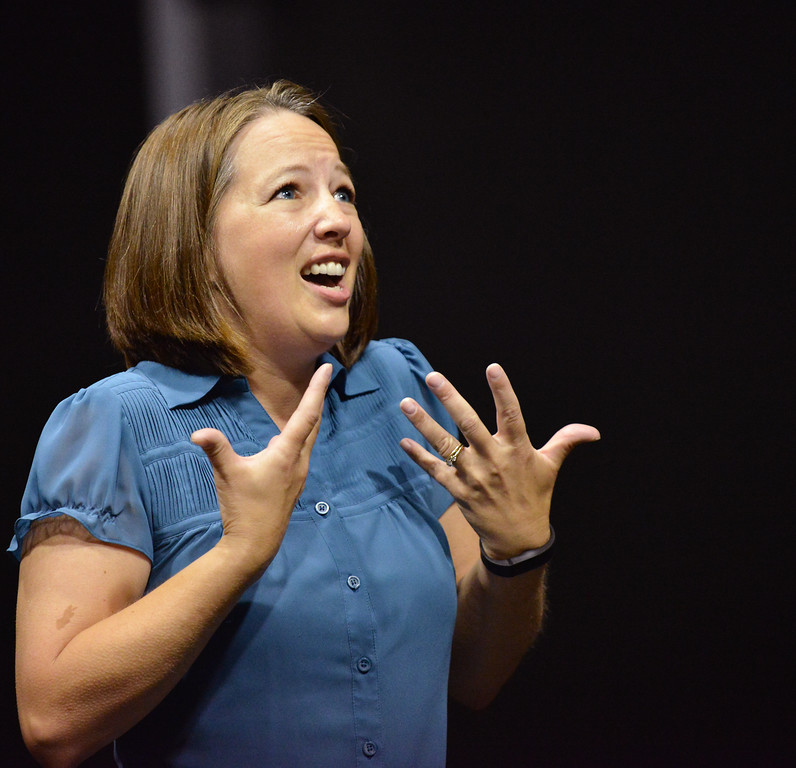 "Becki Arneson sings during the auditions for ""42nd Street"" Wednesday night at the Mars Theater. The musical production will be the feature at this year's Gala fundraiser for the WYO Theater on October 18. The Sheridan Press
