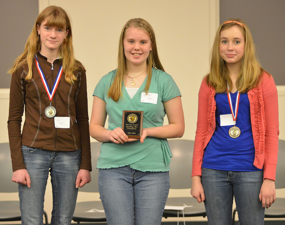 The winners of the Sheridan County Spelling bee stand with their awards Thursday at the Sheridan College Whitney Presentation Hall. From left, Trinity Preston, second place; Emmalee Hoopes, First prize; and third-place winner Caroline Haile will be going to the state spelling bee.