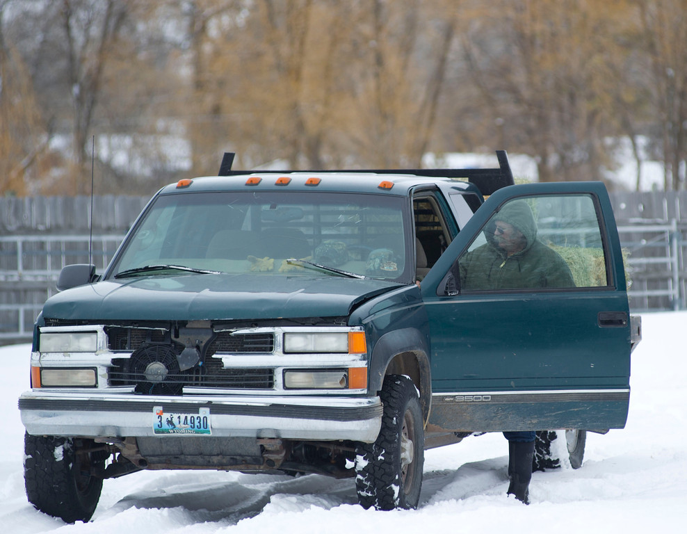 Toby Johnson starts up his work truck Tuesday morning to feed his livestock on his ranch in Big Horn.