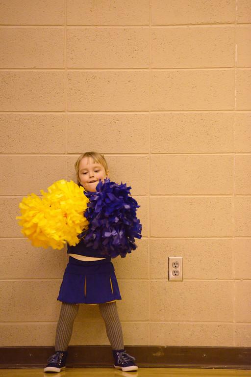 Aylah Erickson, 3, plays cheerleader as the Lady Broncs warm up Friday evening at Sheridan High School.