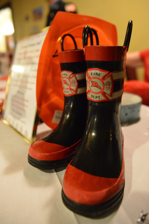 A pair of miniature fireman's boots are seen at the guest table.