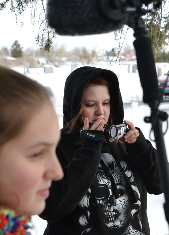 """Sheridan High School Broadcast Journalism student Sonja Kunsman video records the students setting up the scene last week at the Sheridan Municipal Cemetery. The video crew is working on a visual element that will be in the upcoming theater production of """"Grease."""" Kunsman has been video documenting the progress of the production of """"Grease,"""" which shows at the Sheridan High School auditorium Wednesday, March 5th through Saturday, March 8th at 7:30p.m. and on Sunday, March 9th at 2:00p.m."""