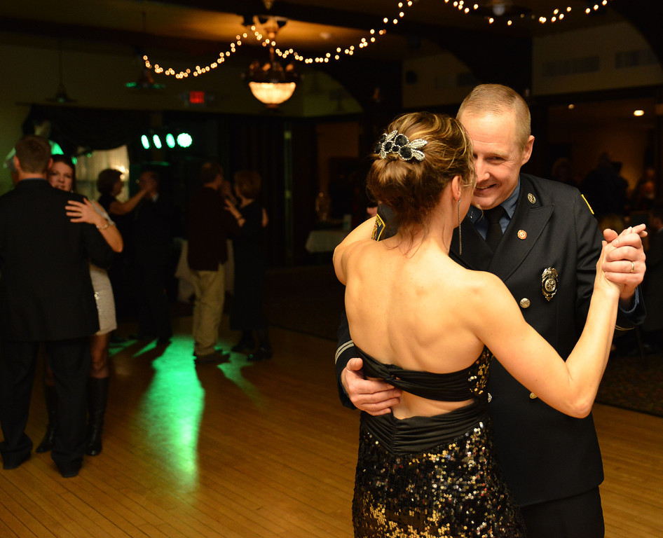 Sheridan fireman John Syring  dances with his wife Michelle Syring Saturday night during the annual Fireman's Ball at the Sheridan Inn. The fundraising event was to fund a firefighter statue that is to be built in front of the Sheridan Fire-Rescue firehouse.