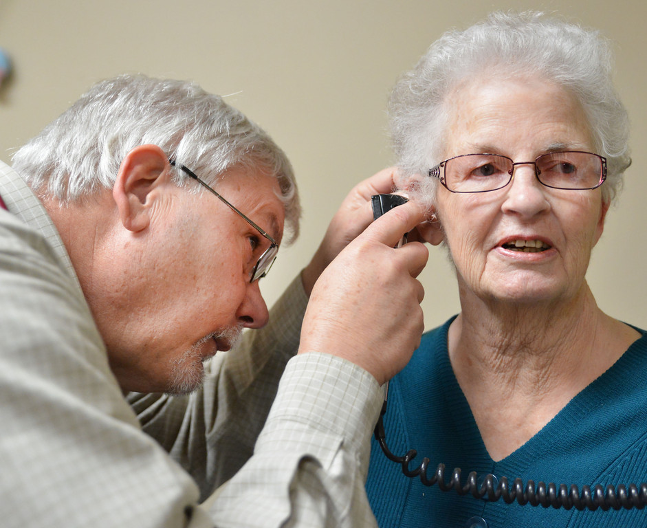 Dr. Finley examines Eilene Johnson's ear for signs infection and congestion Tuesday at the Urgent Care Clinic of Sheridan on Sugarland Drive.