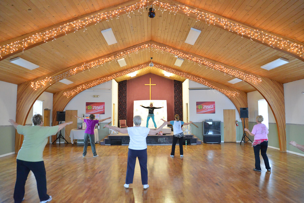 Zumba Gold Instructor Denise Wood leads the group in the old sanctuary at the Family Life Church on Thursday.