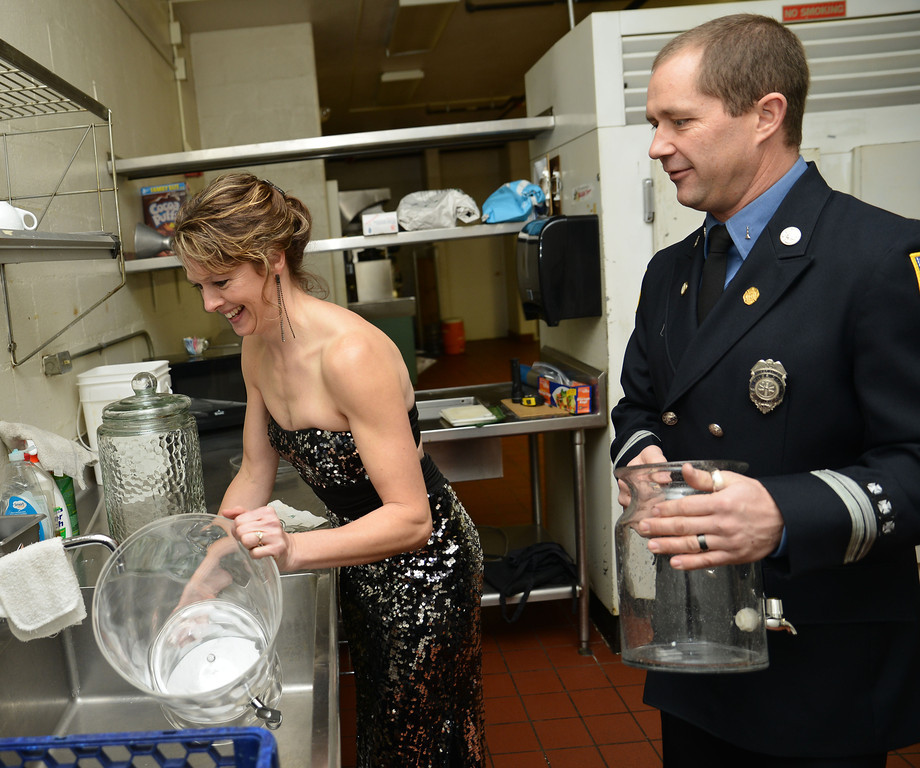 Michelle Syring fills pitchers of water as George Neeson helps during the annual Fireman's Ball outside of the Sheridan Inn Saturday night. The fundraising event was to fund a firefighter statue that is to be built in front of the Sheridan Fire-Rescue firehouse.