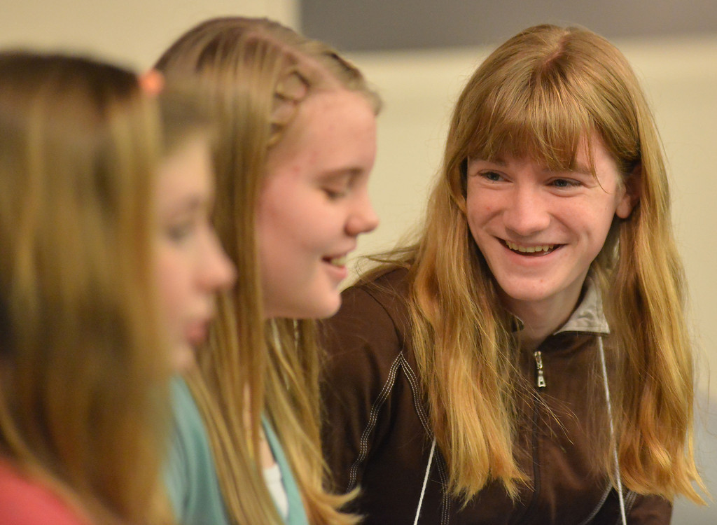 Trinity Preston makes a brief remark to another competitor when the final rounds of the Sheridan County Spelling Bee drag on as the last three contestants fail to spell the words correctly for first and second placement Thursday at the Sheridan College Presentation Hall.