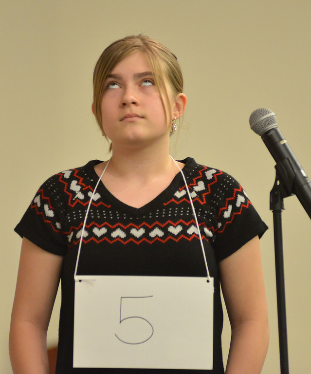 Taylor Myers looks at the ceiling as the Pronouncer gives her a word to spell during the Sheridan County Spelling Bee Thursday morning at the Sheridan College Whitney Presentation Hall.