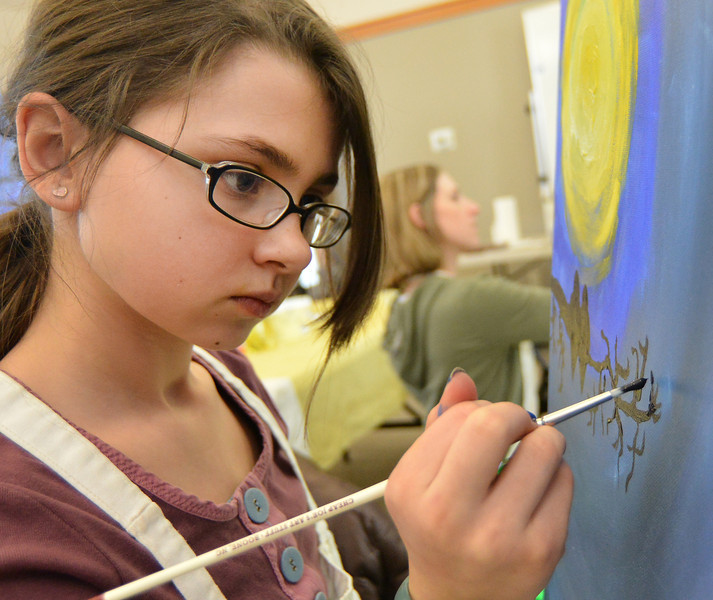 McKenna Arndt, 11, works on the foreground element of the painting during Uncapped: 'Birds of a Feather' painting workshop Saturday at the Sagebrush Community Art Center.