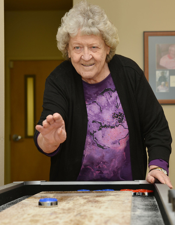 Ruby Sackett plays shuffle board Friday morning at Day Break in the Sheridan Senior Center.