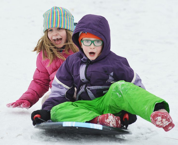 "Suzie Foster, left, and Danielle Gilbert, ages 6 and 7, scream as they fly down Kendrick hill Friday afternoon. Almost a hundred children were given sleds purchased by Century 21 BHJ Real Estate after spending most the afternoon sledding on Kendrick hill and eating hotdogs. Century 21 BHJ Realty owner Bruce Garber expressed that he wanted to celebrate the spirit of the Olympics in Sheridan, since Century 21 is the sponsor of the US men's and women's Bobsled and Skeleton teams at the 2014 Olympics. ""It's all about seeing the kids smile."" Garber said."