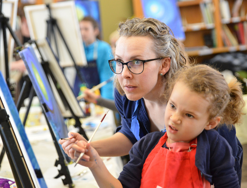 Misty Stoll leans in as her 6-year-old daughter Natalie Stoll evaluates her own work during Uncapped: 'Birds of a Feather' painting workshop Saturday at the Sagebrush Community Art Center.