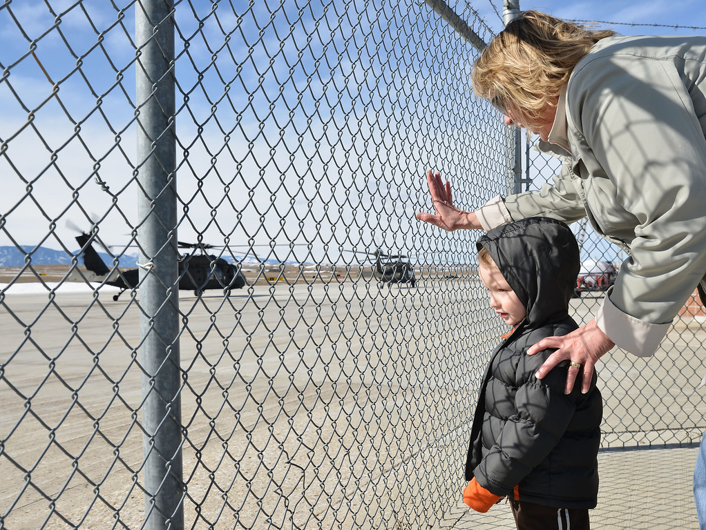 Michael Roe, 2, watches a group of Black Hawk helicopters take off from the Sheridan County Airport Thursday with his grandmother Teresa Peterson. The military aircraft made a brief fueling stop in Sheridan.