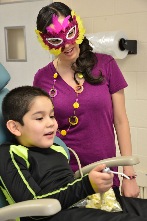 Diego Martinez plays with an air tool as dental student Elizabeth Garcia instructs him to aim at a nearby balloon during the circus themed tour of the Dental Hygiene Department Thursday at Sheridan College. The Dental Hygiene students hosted kindergarten classes from Sheridan County to commemorate National Children's Dental health Month. The Dental Hygiene Department also sought to help the youth to become familiar with the dental office and equipment so they can feel more comfortable around them.