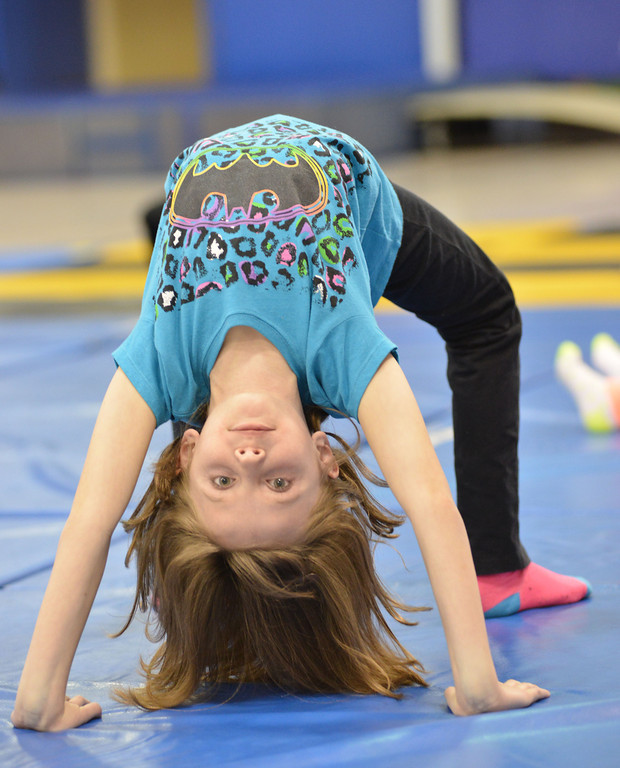 Seven-year-old Lilly Charest does a back bend during the Sheridan Rec District's Tumbling Class Tuesday night at Sagebrush Elementary School.
