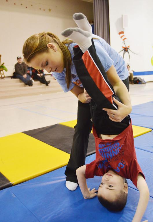Instructor Whitney McCalla helps Eric Venn, 5, do a hand stand during the Sheridan Rec District's Tumbling Class Tuesday night at Sagebrush Elementary School.