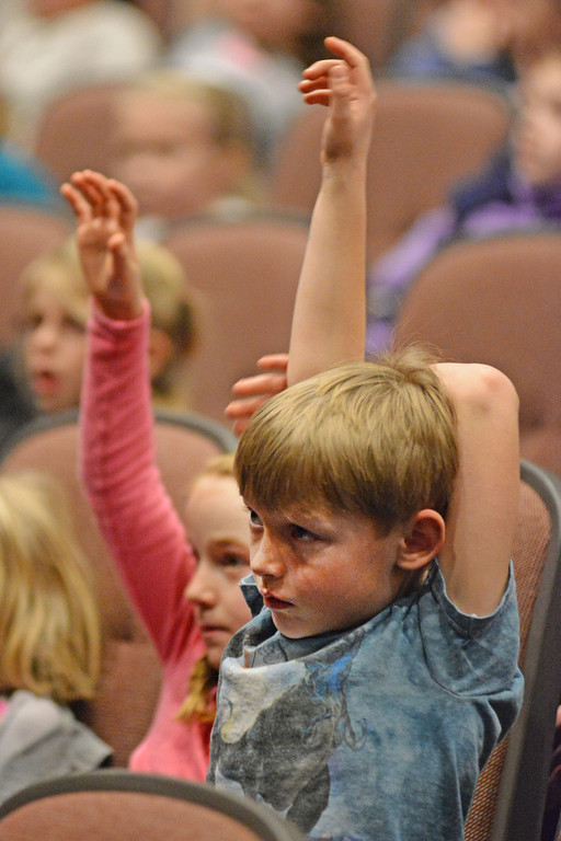 Trace Nelson, a Big Horn first grader, raises his hand during Marvin Nash's Bullying Hurts program Wednesday at the Big Horn High School auditorium.