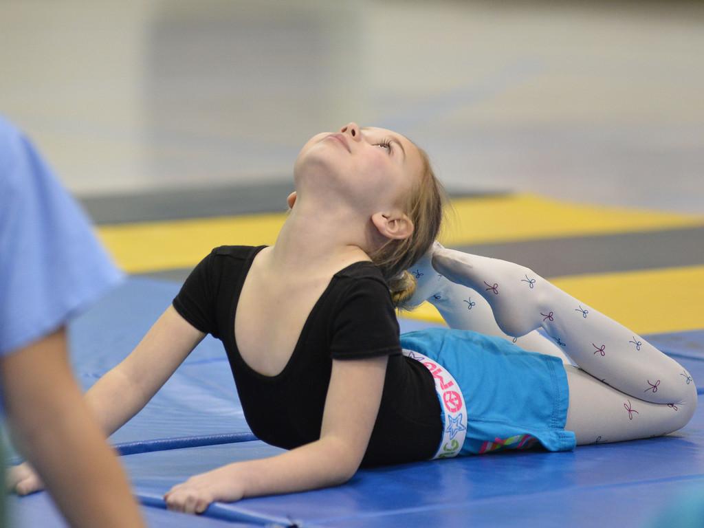 Abby Venn, 6, stretches during the Sheridan Rec District's Tumbling Class Tuesday night at Sagebrush Elementary School.