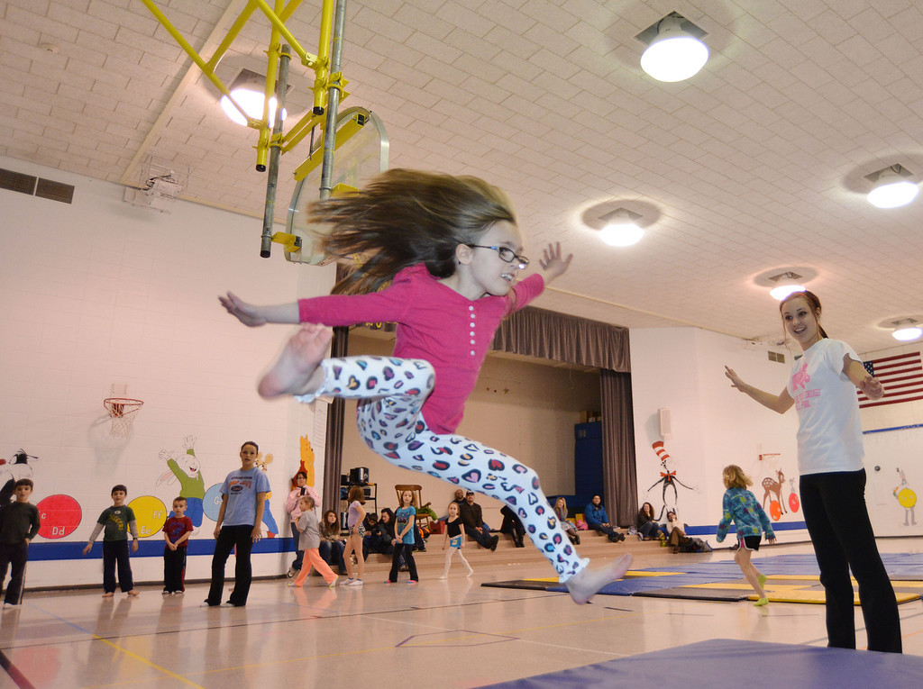 Abby Leno, 9, jumps off the springboard during the Sheridan Rec District's Tumbling Class Tuesday night at Sagebrush Elementary School.