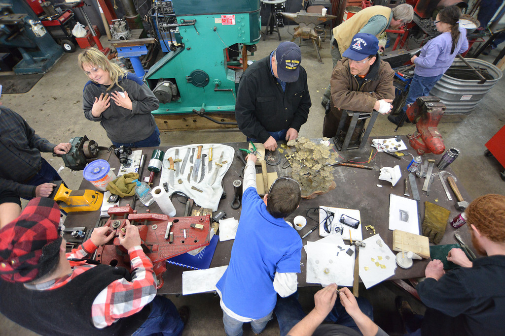 Blacksmiths from the region, including Montana and the Dakotas, gather around the table to make stacks of metals to be forged during the Wyoming Artist Blacksmiths 'Winter Forge-in' Saturday at Bomar's Shop on Leopard Street in Sheridan.