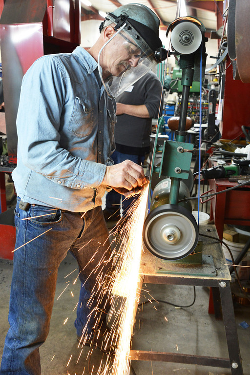 Duane Bomar grinds down a piece of metal during the Wyoming Artist Blacksmiths 'Winter Forge-in' Saturday at Bomar's Shop on Leopard Street in Sheridan