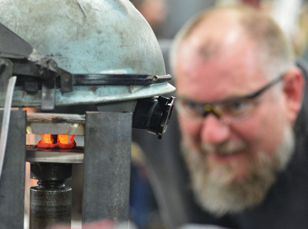 A black smith carefully squeezes a heated billet inside a clamp during the Wyoming Artist Blacksmiths 'Winter Forge-in' Saturday at Bomar's Shop on Leopard Street in Sheridan.